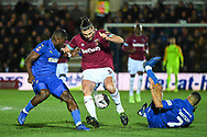 West Ham United forward Andy Carroll (9), Wimbledon defender Adedeji Oshilaja (4) and Wimbledon defender Tennai Watson (2) battle for the ball during the The FA Cup fourth round match between AFC Wimbledon and West Ham United at the Cherry Red Records Stadium, Kingston, England on 26 January 2019.