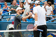 Russia's Dmitry Tursunov congratulates USA's John Isner after their men's semifinals singles match at the Citi Open ATP tennis tournament in Washington, DC, USA, 3 Aug 2013.  Isner won the match 6-7, 6-3, 6-4 to advance to the final on Sunday.