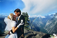 Newlyweds David and Susan Nord from Michigan seal their love with a kiss at Glacier Point in Yosemite National Park, September 17, 1993.  The ceremony was performed by the Hon. Judge Don Pitts, ret. who was the Federal Magistrate in the park.