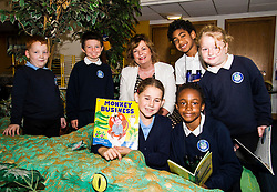 Pictured: Callum McCallion (7), Sean McNeil (8) Markus Rawalai (8), Sarah Keir (8) Glidh Stewart (7) and Anjola Abiadum Emmanuel (7) joined Ms Hyslop to check out some books.<br /> Culture Secretary Fiona Hyslop MSP visited Wester Hailes Library in Edinburgh today to meet primary-school pupils and Edinburgh City Council officials  to announce libraries support package<br /> <br /> Ger Harley   EEm 7 September 2016