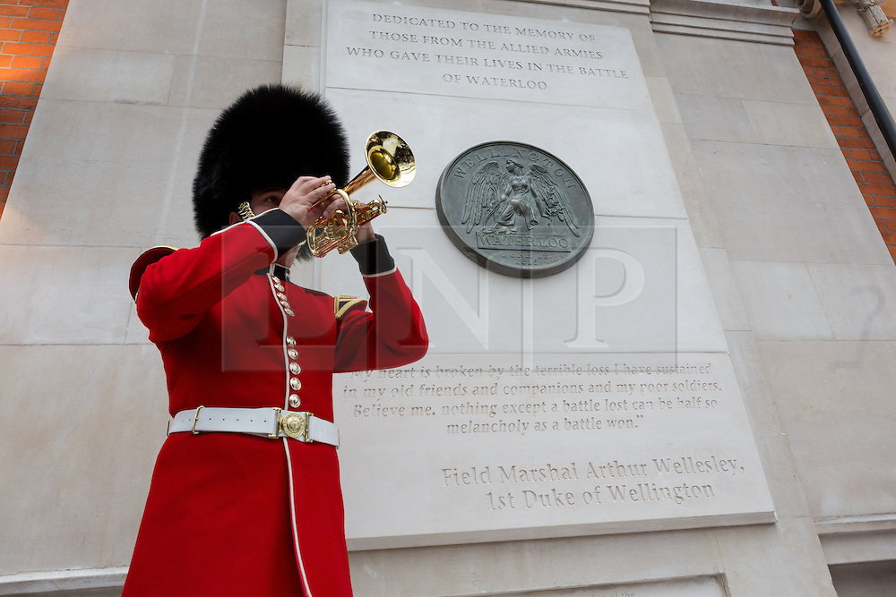© Licensed to London News Pictures. 10/06/2015. London, UK. A bugler plays the Last Post at the Battle of Waterloo memorial unveling at Waterloo station in London. Photo credit : Vickie Flores/LNP