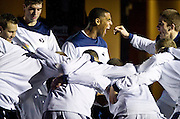 BYU forward Brandon Davies, center, gets the Cougars fired up before the NCAA basketball game between the BYU Cougars and the Northern Arizona Lumberjacks at Marriott Arena, Thursday, Dec. 27, 2012.