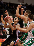 .Navajo Pine Warriors Timothy Chee (1) tries to find an open shot as  Hagerman Bobcat Leonard Hamilton(20) Michael Garcia (4) Ryan Gomez (11) defend during the first half of Wednesday nights game at the Santa Anna Star Center in Rio Rancho NM. Hagerman defeated Navajo Pine 76-61.