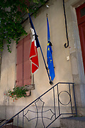 Patriotic French and EU flags outside a village Mairie, on 26th May, 2017, in Villerouge-Termenes, Languedoc-Rousillon, south of France