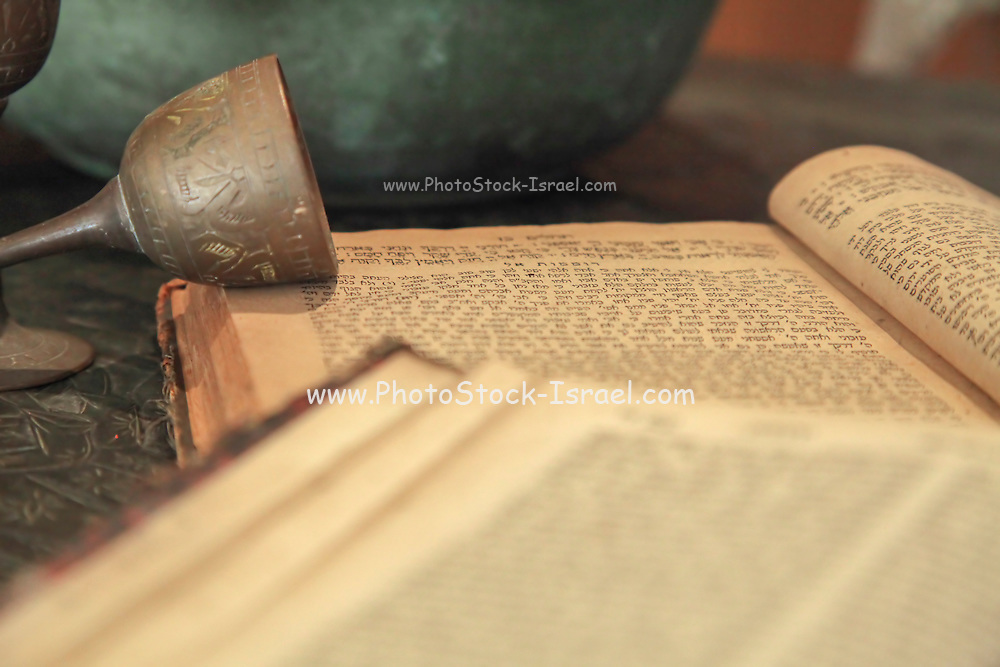 Ancient Kiddush cup and Tehilim (Psalms) book, at the Babylonian Jewry heritage center
