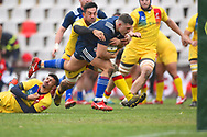 USA player Bryce Campbell breaks through Romanian tacklers to score a try in the first half during the November Test match between Romania and USA at Ghencea Stadium, Bucharest, Romania on 17 November 2018.
