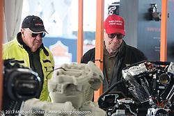 Checking out Milwaukee-eight engine models at the Harley-Davidson display at the Daytona Speedway during Daytona Bike Week. Daytona Beach, FL. USA. Wednesday March 15, 2017. Photography ©2017 Michael Lichter.