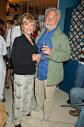 EDINA RONAY and DICK POLAK at a party to celebrate the publication of 'A Girl From Oz' by Lyndall Hobbs held at Flat 1, 165 Cromwell Road, London on 12th May 2016.