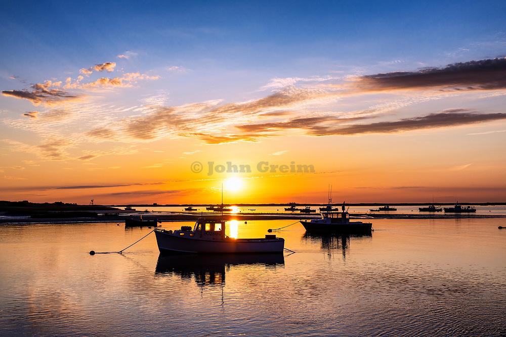 Fishing boat sunrise in Chatham Harbor, Cape Cod, Massachusetts, USA.