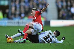Derby County's Omar Mascarell tackles Nottingham Forest's Ben Osborn - Photo mandatory by-line: Dougie Allward/JMP - Mobile: 07966 386802 - 17/01/2015 - SPORT - Football - Derby - iPro Stadium - Derby County v Nottingham Forest - Sky Bet Championship