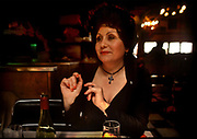Night club singer, Louisette, specialising in Edith Piaff songs, in her resturant in the flea market of Porte de Clignancourt, 10th May 1980, Paris, France. Rumor has it that Edith Piaf used to sing there. Singing French classics is still a major part of the experience, especially on Sundays.