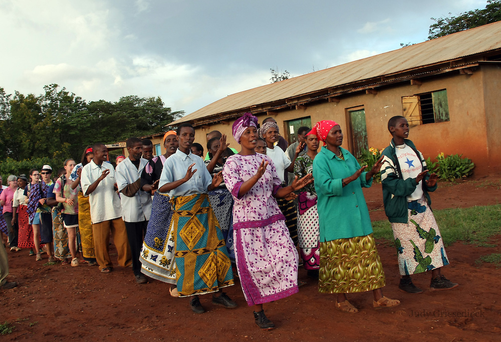 Villagers ib Bossodawish, Tanzania, do a frewell dance for visitors.