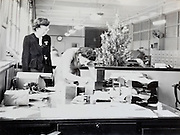office department with two female secretaries USA 1940s