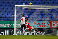 Bolton Wanderers Eóin Doyle(9) has a shot  locked by Crawley Town's Archie Davies during the EFL Sky Bet League 2 match between Bolton Wanderers and Crawley Town at the University of  Bolton Stadium, Bolton, England on 2 January 2021.
