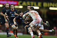 Alex Cuthbert  of Wales is tackled by Georgia's Merab Sharikadze  (12). Under Armour 2017 series Autumn international rugby, Wales v Georgia at the Principality Stadium in Cardiff , South Wales on Saturday 18th November 2017. pic by Andrew Orchard, Andrew Orchard sports photography