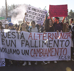 October 13, 2017 - Rome, Italy - Students have demonstrated throughout Italy against school reform that provides many hours of free work without any connection to their study path. In Rome, students reached the ministry of education denouncing the exploitation in restaurants, crickets and construction sites instead of training as the apprenticeship should be. (Credit Image: © Elisa Bianchini/Pacific Press via ZUMA Wire)
