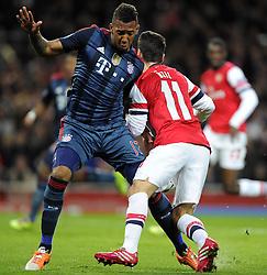 Arsenal's Mesut Ozil is fouled by Bayern Munich's Jerome Boateng and awarded a penalty - Photo mandatory by-line: Joe Meredith/JMP - Tel: Mobile: 07966 386802 19/02/2014 - SPORT - FOOTBALL - London - Emirates Stadium - Arsenal v Bayern Munich - Champions League - Last 16 - First Leg