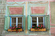 Windows in the Engadine Valley in the village of Guarda - old painted stone 17th Century buildings, Switzerland