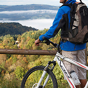 Mountain biker looking over the valley nearby Ambert