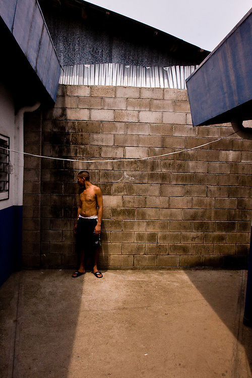 An 18th street gangmember in the jail in Ciuadad Arce. There are no programs or activities for jailed gangmembers in the countries overcrowded prisions.