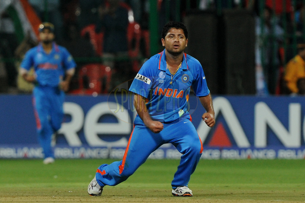 Piyush Chawla of India celebrate a wicket during the ICC Cricket World Cup match between India and England held at the M Chinnaswamy Stadium in Bengaluru, Bangalore, Karnataka, India on the 27th February 2011..Photo by Pal Pillai/BCCI/SPORTZPICS