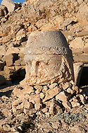 Statue head of Zeus in front of the stone pyramid 62 BC Royal Tomb of King Antiochus I Theos of Commagene, east Terrace, Mount Nemrut or Nemrud Dagi summit, near Adıyaman, Turkey .<br /> <br /> If you prefer to buy from our ALAMY PHOTO LIBRARY  Collection visit : https://www.alamy.com/portfolio/paul-williams-funkystock/nemrutdagiancientstatues-turkey.html<br /> <br /> Visit our CLASSICAL WORLD HISTORIC SITES PHOTO COLLECTIONS for more photos to download or buy as wall art prints https://funkystock.photoshelter.com/gallery-collection/Classical-Era-Historic-Sites-Archaeological-Sites-Pictures-Images/C0000g4bSGiDL9rw