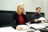 24 JAN 2006, BERLIN/GERMANY:<br /> Dagmar Enkelmann, PDS/Die Linke Stellv. Fraktionsvorsitzende, telefoniert und blaettert in uNterlagen, vor Beginn der Fraktionssitzung der Linkspartei, Deutscher Bundestag <br /> IMAGE: 20060124-01-019<br /> KEYWORDS: Telefon, telefonieren, Akte, Akten, lesen, liest
