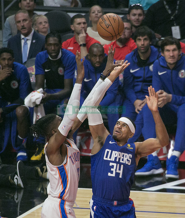 October 19, 2018 - Los Angeles, California, U.S - Tobias Harris #34 of the Los Angeles Clippers battles Dennis Schroder #17 of the Oklahoma Thunder for the ball during their NBA game on Friday October 19, 2018 at the Staples Center in Los Angeles, California. Clippers defeat Thunder, 108-92. (Credit Image: © Prensa Internacional via ZUMA Wire)
