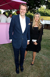 TOM PARKER BOWLES and his wife SARA at the Serpentine Gallery Summer party sponsored by Yves Saint Laurent held at the Serpentine Gallery, Kensington Gardens, London W2 on 11th July 2006.<br />