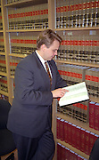Lawyer age 27 reading thoughtfully in law library  Chicago  Illinois USA