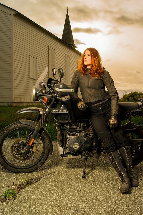 Aerial performer and volunteer wildland firefighter Erin Carey with her Royal Enfield motorcycle.