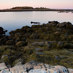 The rocky coast of Timber Point before sunrise in Biddeford, Maine