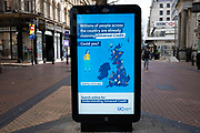 HM Government, and NHS advertising boards advice for claiming Universal Credit in Birmingham city centre is virtually deserted due to the Coronavirus outbreak on 31st March 2020 in Birmingham, England, United Kingdom. Following government advice most people are staying at home leaving the streets quiet, empty and eerie. Coronavirus or Covid-19 is a new respiratory illness that has not previously been seen in humans. While much or Europe has been placed into lockdown, the UK government has announced more stringent rules as part of their long term strategy, and in particular social distancing.