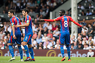 Crystal Palace (8) Cheikhou Kouyate, James Tomkins (5) of Crystal Palace, Luka Milivojević (4) of Crystal Palace during the Premier League match between Fulham and Crystal Palace at Craven Cottage, London, England on 11 August 2018.