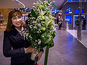 09 NOVEMBER 2018 - BANGKOK, THAILAND: A woman delivers flowers to a shop opening in the ICONSIAM mall in Bangkok. ICONSIAM opened November 9. ICONSIAM is a mixed-use development on the Thonburi side of the Chao Phraya River. It includes two large malls, with more than 520,000 square meters of retail space, an amusement park, two residential towers and a riverside park. It is the first large scale high end development on the Thonburi side of the river and will feature the first Apple Store in Thailand and the first Takashimaya department store in Thailand.    PHOTO BY JACK KURTZ