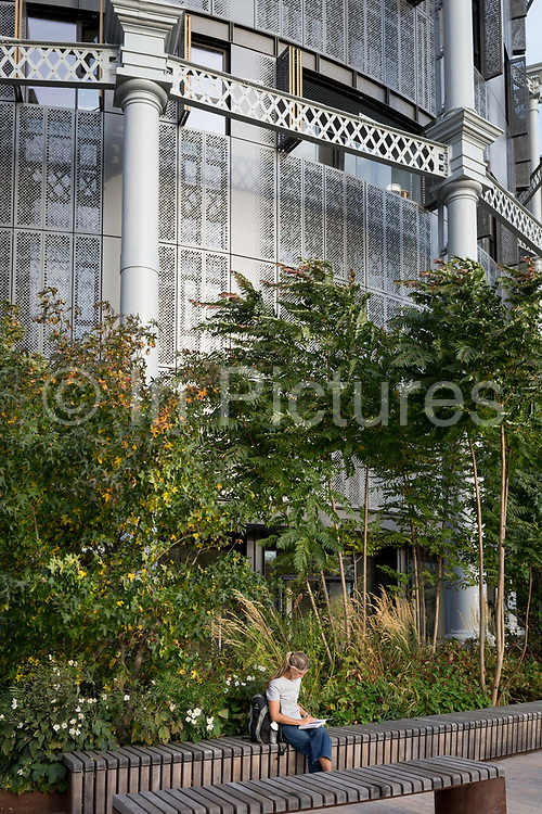 Londoners enjoy autumnal sunshine at Gasholders Park, on 16th October 2018, in London, England. The iconic structures were built in the 1850s as part of Pancras Gasworks. Typical volumes for large gas holders are about 50,000 cubic metres, with 60 metres diameter structures. The gasholders remained in use until the late 20th Century and were finally decommissioned in 2000. Gasholder Park is designed by Bell Phillips Architects.