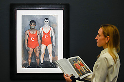 """© Licensed to London News Pictures. 22/11/2019. LONDON, UK. A staff member views """"Wrestlers"""", 1933, by Vladmir Lebedev (Est. GBP30-50k) at the preview for the upcoming sales of Russian artworks at Sotheby's New Bond Street.  The Russian Pictures and Works of Art, Fabergé and Icons sales take place on 26 November.  Photo credit: Stephen Chung/LNP"""