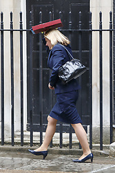 June 27, 2017 - London, London, UK - London, UK. Education Secretary JUSTINE GREENING gets caught in the rain whilst leaving a cabinet meeting in Downing Street and uses her ministerial folder to take shelter in London on Tuesday, 27 June 2017. (Credit Image: © Tolga Akmen/London News Pictures via ZUMA Wire)