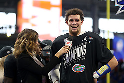 Florida Gators quarterback Feleipe Franks #13 stands on stage to accept his MVP award after winning the Chick-fil-A Peach Bowl, Saturday, December 29, 2018, in Atlanta. (Jason Parkhurst via Abell Images for Chick-fil-A Peach Bowl)