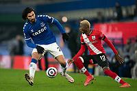 Football - 2020 / 2021 Premier League - Everton vs Southampton - Goodison Park<br /> <br /> Everton André Gomes is tackled by Southampton's Moussa Djénépo<br /> <br /> <br /> COLORSPORT/TERRY DONNELLY