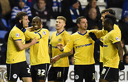 Wigan Athletic's Jason Pearce celebrates with team mates after scoring against Reading in the Sky Bet Championship clash at Madejski Stadium - Photo mandatory by-line: Paul Knight/JMP - Mobile: 07966 386802 - 17/02/2015 - SPORT - Football - Reading - Madejski Stadium - Reading v Wigan Athletic - Sky Bet Championship