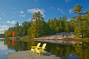 Muskoka (Adirondack) chairs and Red maple tree (Acer rubrum) at Grundy Lake<br />Grundy Lake Provincial Park<br />Ontario<br />Canada<br />Grundy Lake Provincial Park<br />Ontario<br />Canada