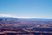 Daytime vista from Deadhorse Point State Park to the La Sal Mountains near Moab, Utah, USA.