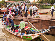 21 OCTOBER 2015 - YANGON, MYANMAR:   Passengers get into a cross river ferry at Botataung Pier, near Botataung Paya on the riverfront in Yangon. PHOTO BY JACK KURTZ