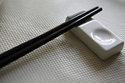Pair of chopsticks resting in a holder