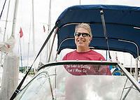 Dan Kallmerten heads out from Fay's Marina for a day on Lake Winnipesaukee.  ©2014 Karen Bobotas Photographer