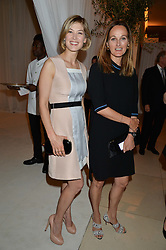 Left to right, ROSAMUND PIKE and the COUNTESS CAWDOR at a dinner hosted by Cartier in celebration of The Chelsea Flower Show held at The Hurlingham Club, London on 19th May 2014.