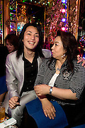 """Host Shou (L) with his customer Etsuko (R) in club """"Ai"""". Club """"Ai"""" (love in Japanese) is one of the oldest host clubs in Kabukicho entertainment area near Shinjuku. It started functioning 37 years ago, with hosts ready to take care of the needs of their female customers. The customers have to pay from 5000 friendly price for beginners, to millions of yen, depending on how good the host is in pleasing the customer and encouraging her to buy drinks. On top of these a good host can receive expensive gifts from his regular customers.  Tokyo - JAPAN"""