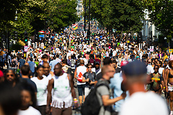 Tens of thousands of revellers throng Ladbroke Grove as day one, Children's Day, of the Notting Hill Carnival gets underway in London. London, August 25 2019.
