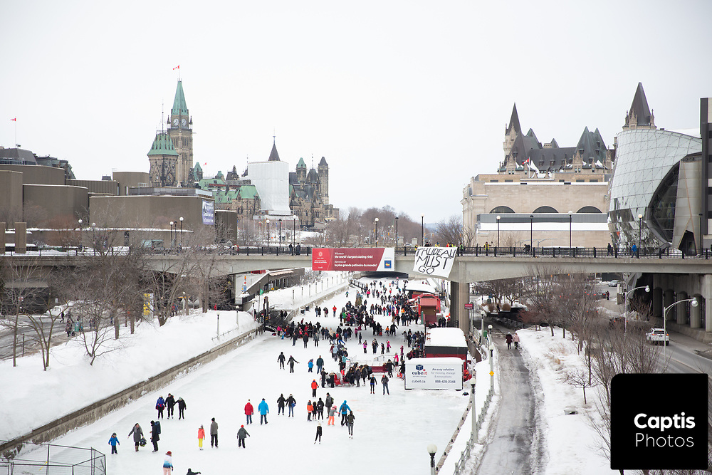 Protesters in yellow vests hold a banner against Prime Minister Justin Trudeau above the Rideau Canal in Ottawa.